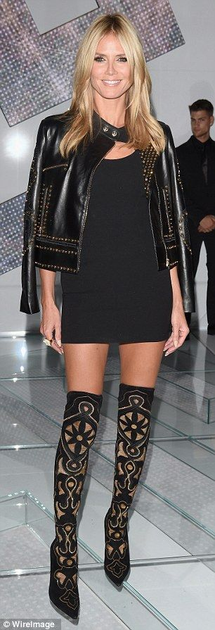 Looking good: She competed her look with a smart little black dress and on-trend leather j...