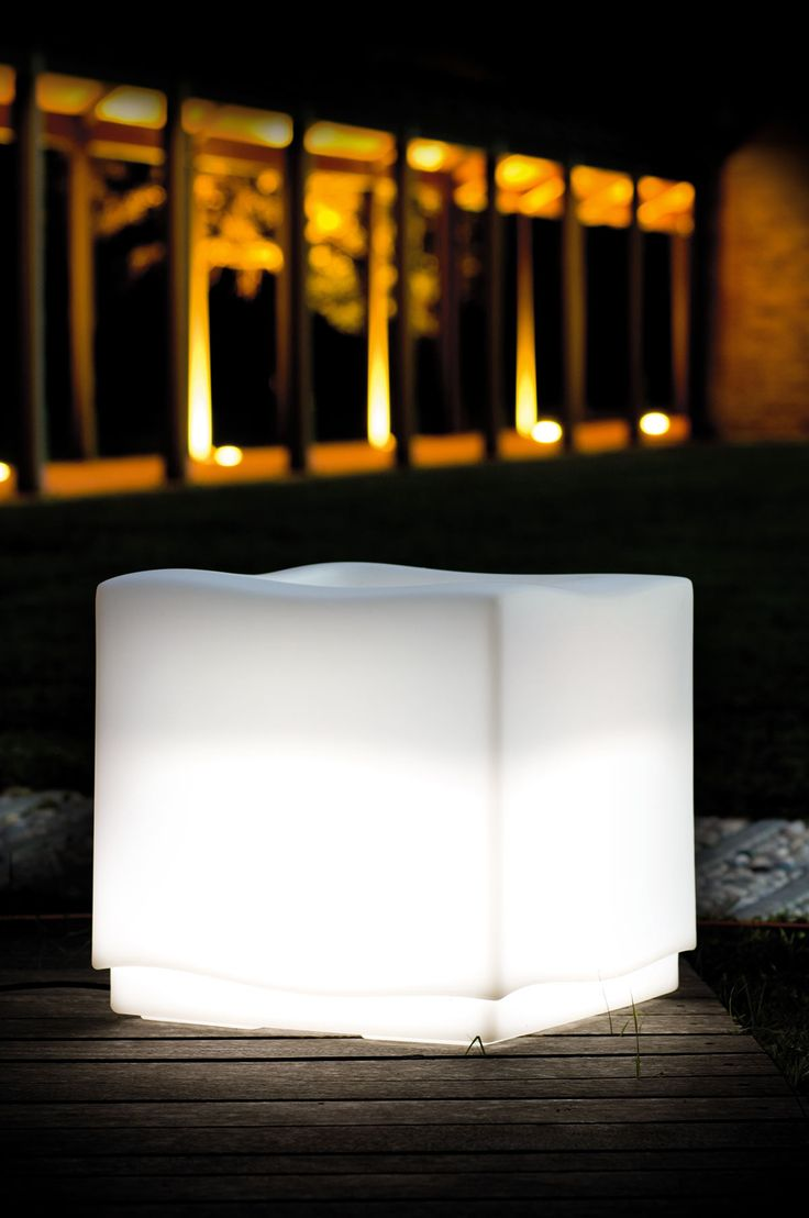 """""""Carrè Lamp"""" is a luminous vase which spreads its light from the base expanding into the environment. Clean and smooth lines gracefully skim the elements surrounding it."""