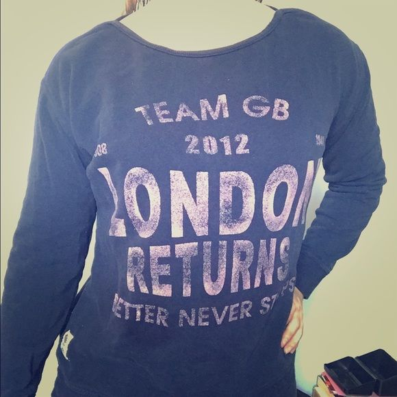 "London 2012 Olympics sweatshirt team GB next uk Picked this up when I was in London in 2012- the year of the last summer Olympics. The sweatshirt says ""London returns"" because it was the second time the Olympics were held there- last time in 1908. ""Better never stops"" was the GB team slogan. This is an official product of team GB sold by Trendy retailer Next. Cool almost boat neck, with a wild band bottom and tie. Navy with pink vintage lettering. Size 8 but I am an XS would fit a S too…"
