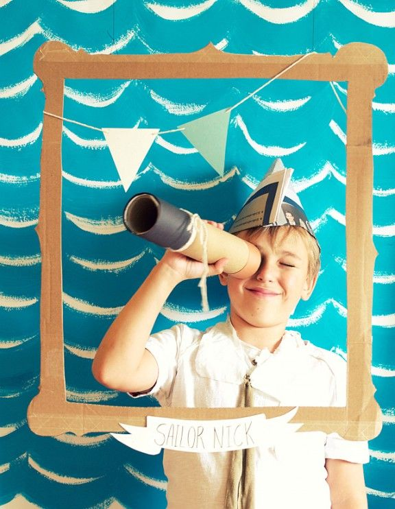 My favorite detail from this sailor-themed party is the sweet photo backdrop with charming props.