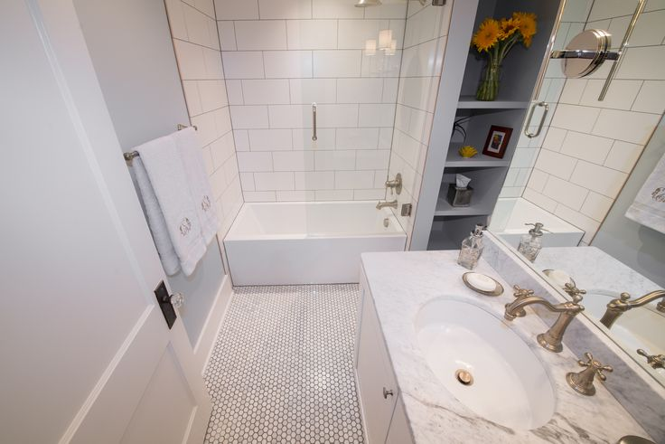 HighCraft-Builders-classic-white-bathroom-remodel-hex-floor-subway-tile-shower-marble-counter-top