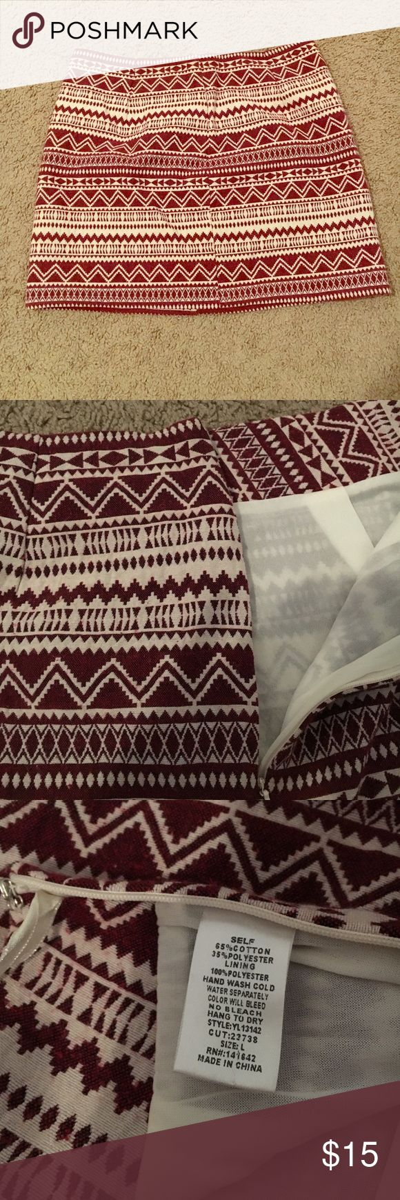 Maroon tribal print skirt Maroon tribal print skirt. High waisted. Zips up the side. True to size. Perfect for game days and nights out! Ya Skirts Mini