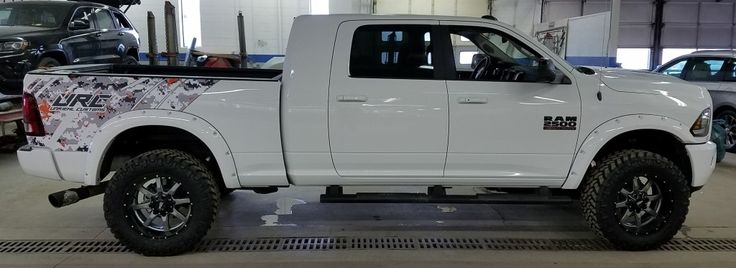 Custom DigiCamo Decals Installed on the Hood and Truck Bed on a White Dodge Ram for @UnRiehlCustoms @FriendlyJeep