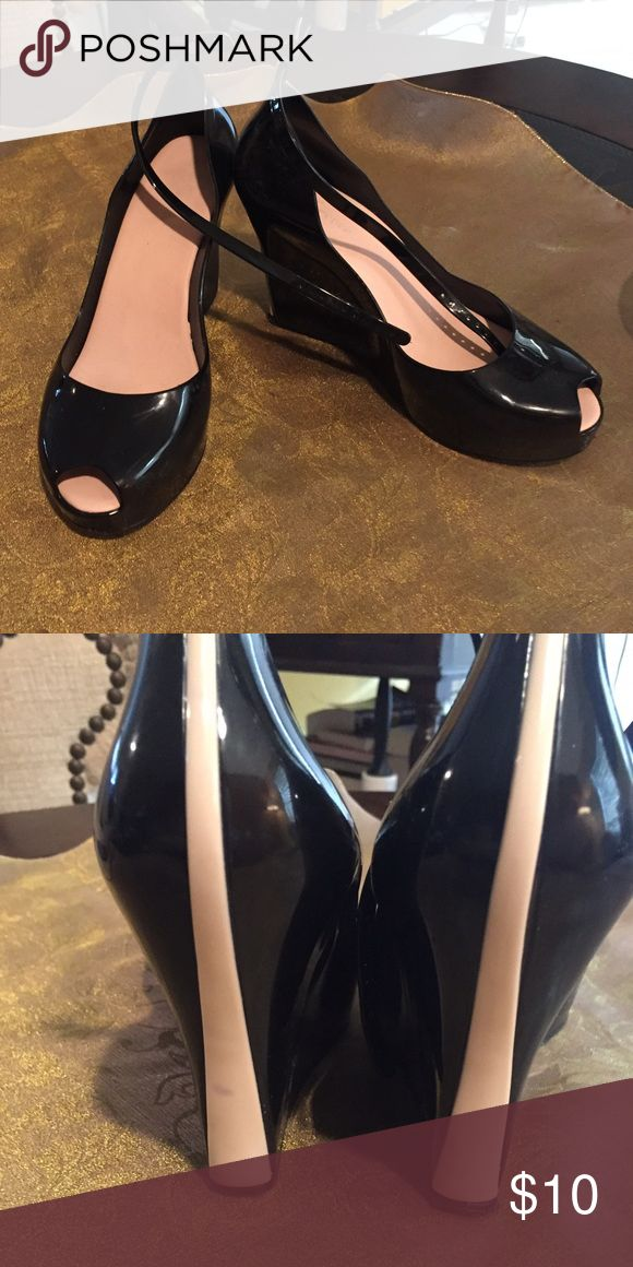 Forever Wedge High Heel Black Plastic Shoes Forever Wedge High Heel Black Plastic Ankle Buckle Shoes. Worn but in good condition. Size 7.5. Light discoloration on back Tan part. See pic. Thank You 😊 Forever Shoes Wedges