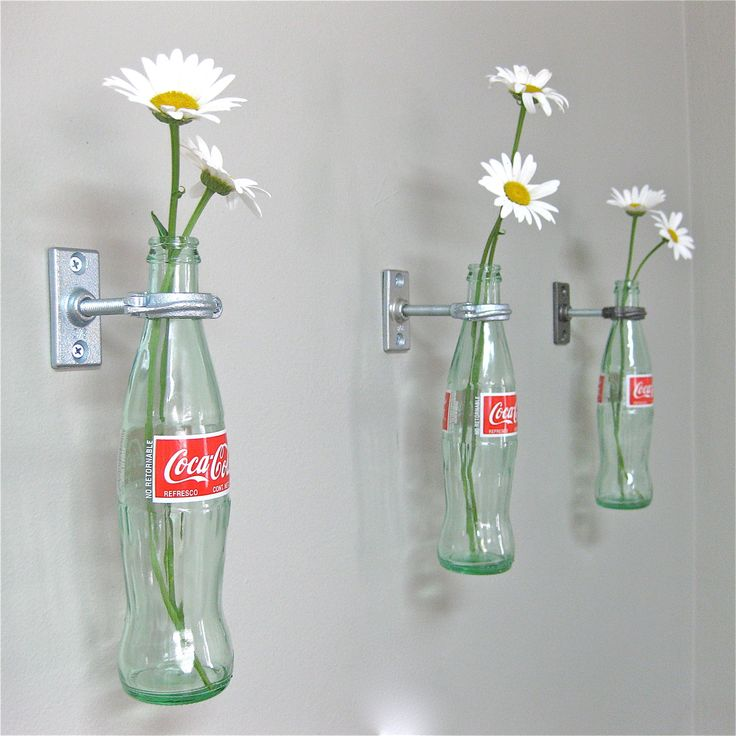 I love this idea! 2 Coca-Cola Bottle Hanging Flower Vases - Red Wall Decor - Vintage Kitchen - 50's Diner. $30.00, via Etsy.