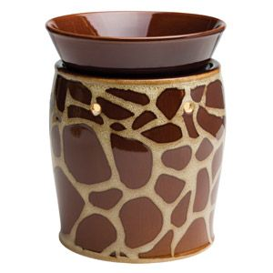 Rich, brown giraffe spots and contrasting white accents create an exotically organic patchwork. To purchase, go to www.jenni.scentsy.com.au