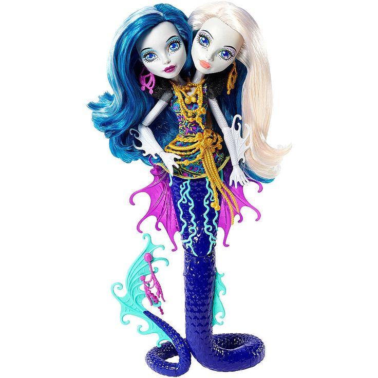 Monster High - Monstruitas Marinas Inseparables, la muñeca Peri y Pearl Serpentine, dos hermanas ¡brillan en la oscuridad y pueden mantenerse en pie por sí solas! ¡La primera monstruita de dos cabezas! Peri y Pearl, hijas del monstruo marino de múltiples cabezas, Hidra, lucen un escalofriante y colorido top que complementa con las joyas de un tesoro de las profundidades. Lo que las hace Buu-única es que ¡no paran de darse cabezazos!