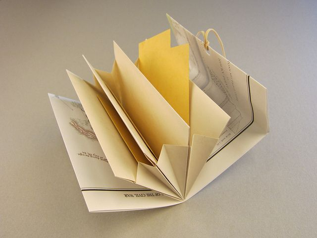 Blizzard Pocket book. A variation on the Blizzard Book (almost a reverse Blizzard Book) which creates a series of pockets that expand to house thicker items. Design: Hedi Kyle