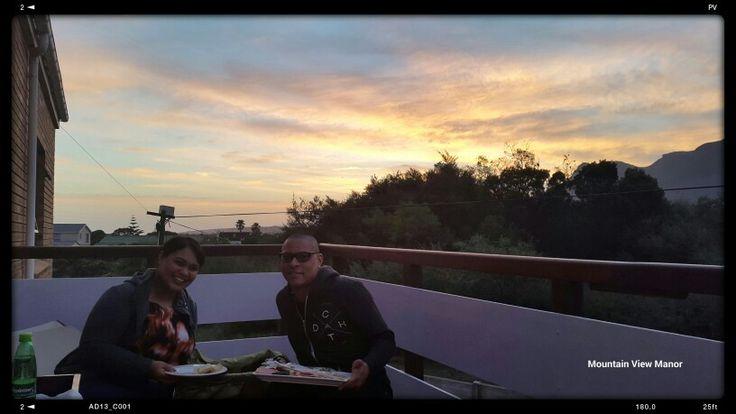 Ian and Laetitia enjoying a #sunset #picnic on the patio @MtViewManor #guesthouse in #sandbaai #hermanus.