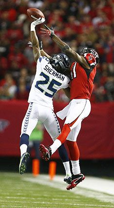 Seahawks cornerback Richard Sherman deflects a pass intended for Atlanta Falcons wide receiver Julio Jones in the first quarter.