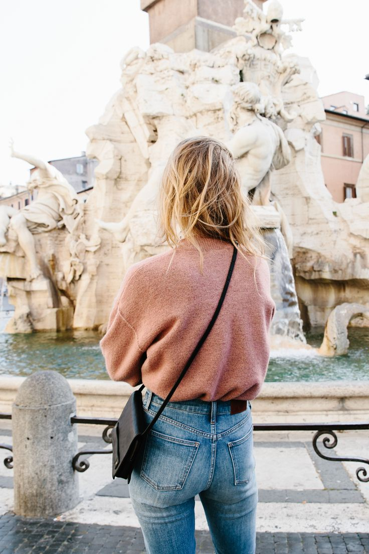 madewell connection sweater in sunset rose, the perfect fall jean + the morgan crossbody bag worn by our muse constance jablonski in our fall catalog shot in rome. #everydaymadewell to pre-order, call 866-544-1037.: