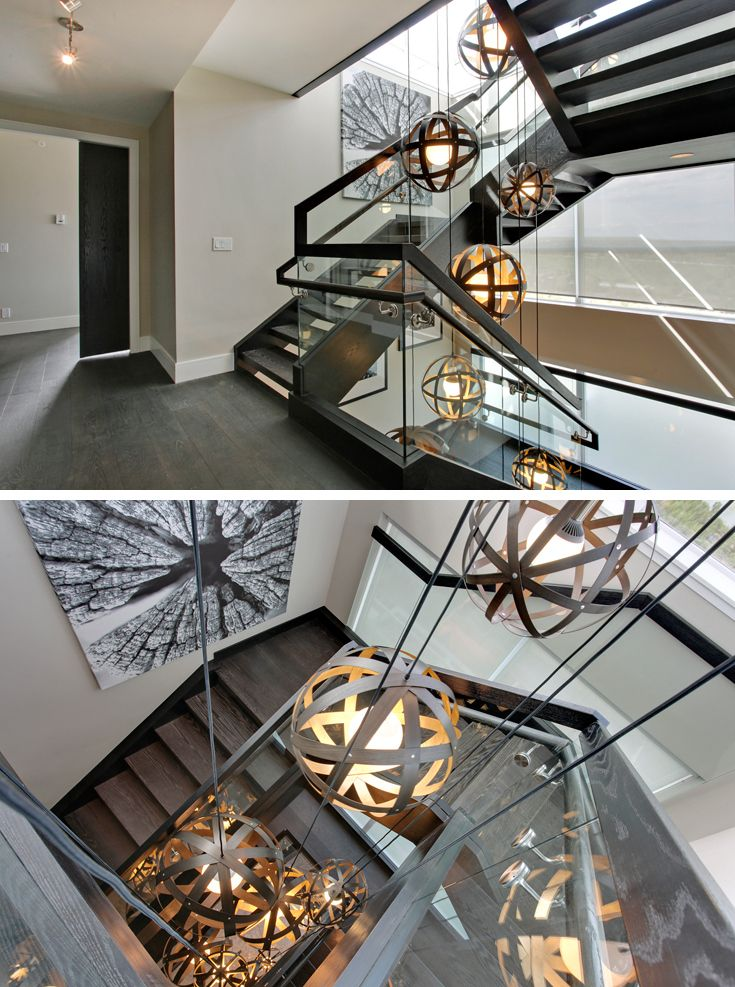 Waterfront Penthouse, Calgary | In collaboration with the talented designers at BBA Design Consultants we created an installation of Meridian lights that cascade down a three storey stairwell. Twelve gold leafed blackened walnut Meridian pendants were hung in a descending cluster.