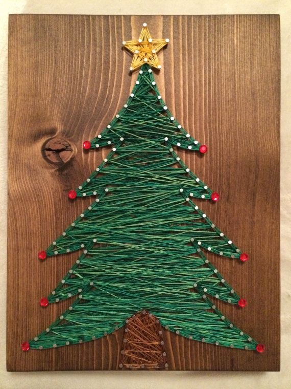 Christmas tree string art, (either 7 by 9 or 11 by 15). You may purchase with or without the ornaments. String colors will be similar to those shown. You may choose the wood stain (dark brown, light brown, white, or gray). A sawtooth hanger is added to every board. If shipping is less than the amount listed, I will refund the difference. Thank you for checking out my listing! You can find more at my Etsy shop- www.KiwiStrings.etsy.com