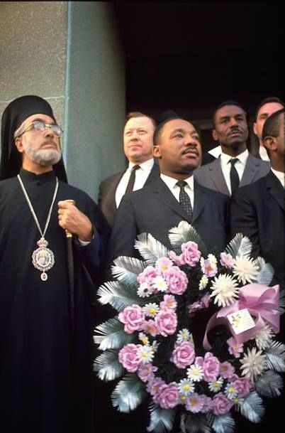 Archbishop Iakovos, Rev. Martin Luther King, Jr., Rev. Abernathy, and Andrew Young honoring Rev. James Reeb in front of the Dallas County Courthouse in Selma, Alabama