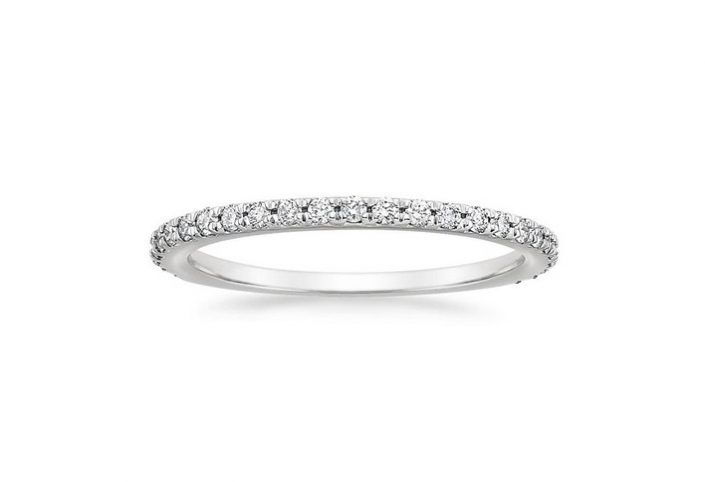 ''Bella'' Half Eternity Ring This classic wedding ring features a glittering row of French pavé diamond accents that wrap around two-thirds of the band.  Timeless and versatile, this beautiful ring serves as the perfect complement to many engagement ring styles.  26 Round Diamond 1.5 mm Total 0,38 ct.
