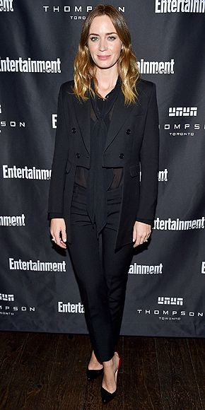 Every Fashion Moment You Need to See from the Toronto Film Festival | EMILY BLUNT | nails the menswear trend with an all-black Saint Laurent ensemble at EW's Must List Party on Sept. 12.