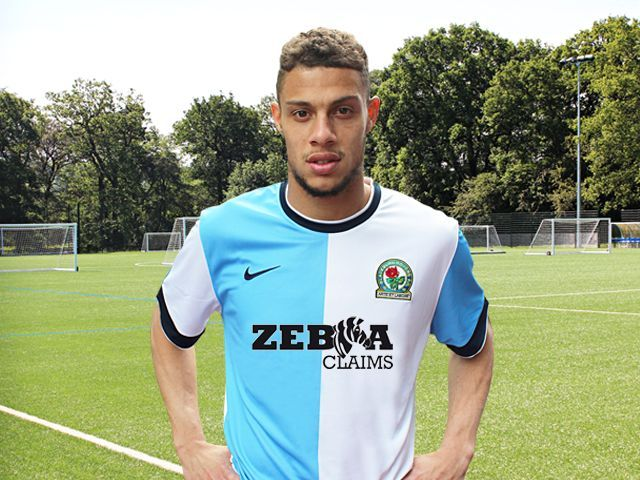 Striker, Rudy Gestede modelling the new home shirt