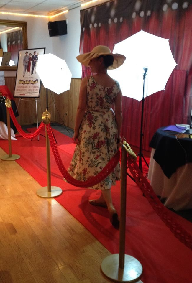 Red Carpet! Set up a red carpet for your guests as they enter the party. With lights, this area can not only be used as a photoboth to take pictures of your guests but also later in the party as a backdrop for a talent show or karaoke! Find the back drops, red carpet and paper red rope at party supply stores. Great for Academy Awards / Tony Awards / Movie/ Hollywood/ Musical Theater themed parties.