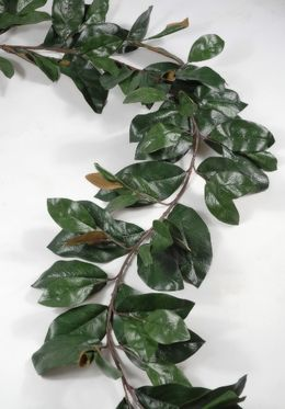 "18.00 SALE PRICE! 6' Magnolia Leaf Garland with 109 leaves  each. 6' x 10"" wide leaves range in size from 4"" to 7.25"" long x 2-1/4"" to..."