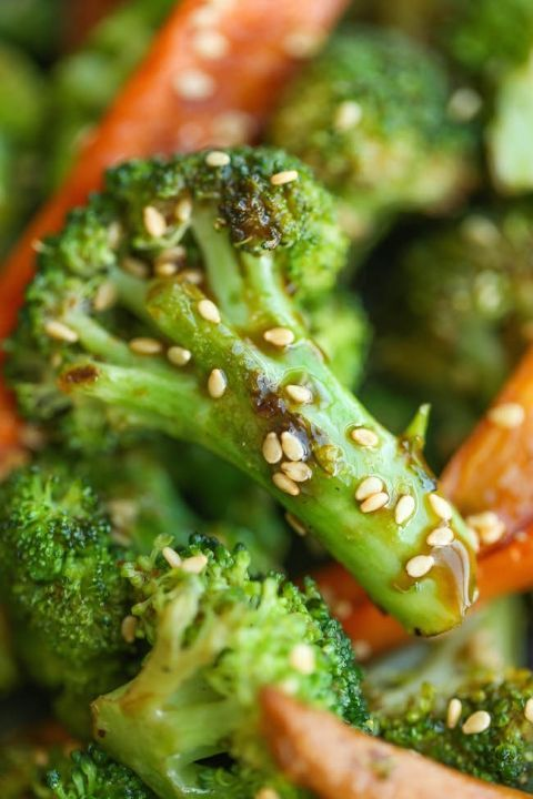 A great veggie side dish for any meat or fish meal, plus the prep time is only 5 minutes. | Asian Roasted Carrots and Broccoli by Damn Delicious
