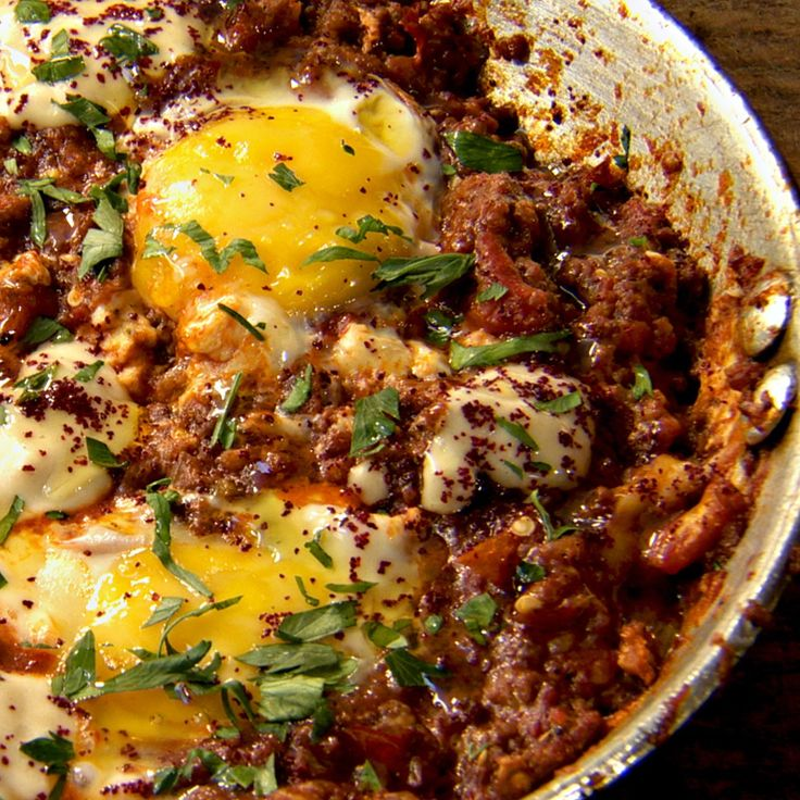 Braised eggs with beef, smoked aubergine and tomato