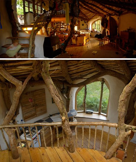 """""""This wonderful organic Woodland Home was built by family, friends and even passers by who stopped to lend a hand. Carved into a hillside and constructed from naturally-shaped walls and roofs, it hides even greater spaces inside."""""""