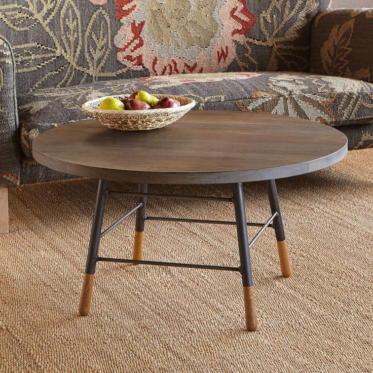 """PENNSYLVANIA DUTCH ROUND COFFEE TABLE--Created by local craftsmen in Pennsylvania, this smooth oak table boasts a sturdy iron base made in an Amish shop, accented with sleek oak feet. Stained dark-wash wood top will vary slightly. USA. Catalog exclusive. 34"""" dia. x 18""""H."""