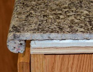 Granite Counter Top Overlays, a DIY-Friendly counter material you can install on top of your existing counter top.  LINKS TO 4 MANUFACTURER SITES.