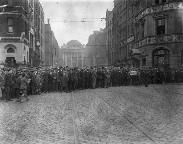 June 1922: Crowds gather outside the Irish Law Courts in Dublin where the anti-treaty section of the IRA have established their headquarters during the Irish Civil War. (Photo by Topical Press Agency/Getty Images)