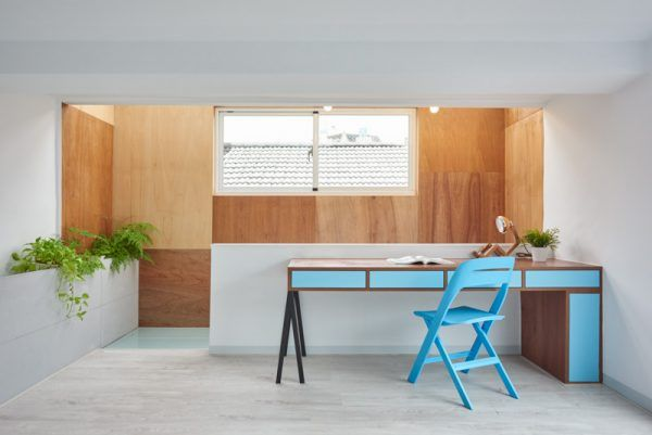 A spark of colour with a bright, turquoise desk breaks the simplicity of the…