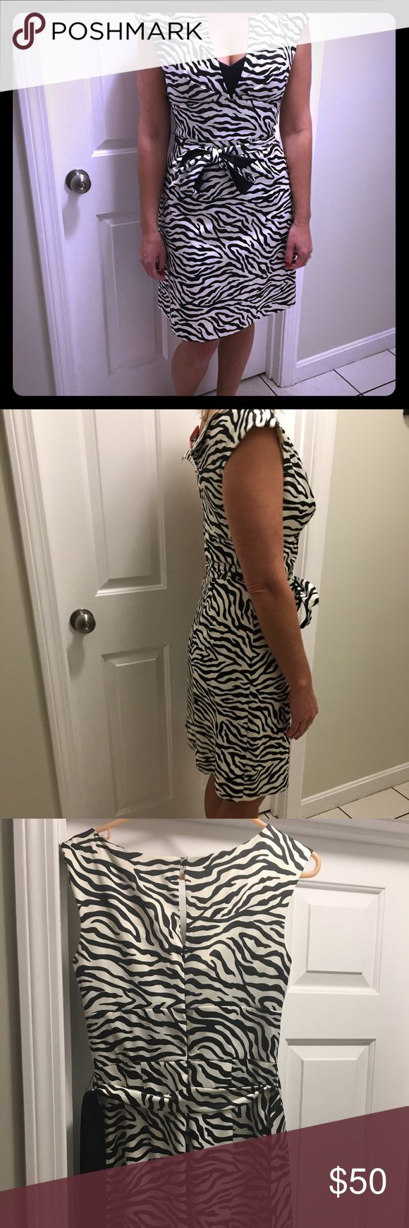 White House Black Market zebra print dress WHBM zebra print dress.  V neck with a little black sweetheart patch, gathered at the waist with 2 sided tie (1 side zebra, 1 side solid black). Worn a few times, EUC, fresh from dry cleaner. Smoke free pet free home. White House Black Market Dresses Midi