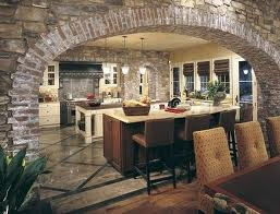 Tuscan style kitchen with stone archway. Yes please.
