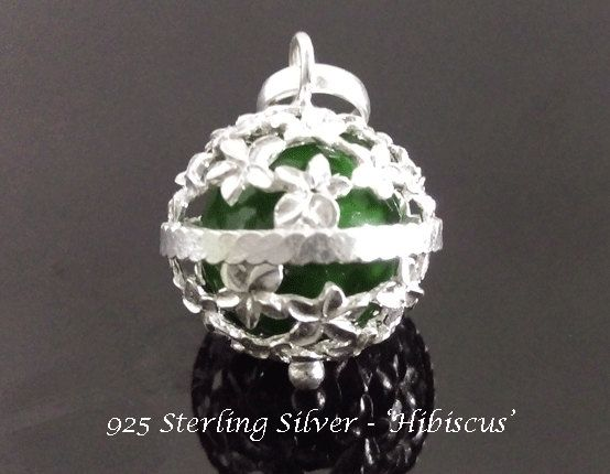 Harmony Ball with Traditional Balinese Hibiscus Flower, Sterling Silver & Green Chime Ball  | Bola Necklace, Pregnancy Gift Angel Caller @ www.harmonyball.net.ay and www.harmonyballpendant.com #harmonyball #jewelry #harmonyballnecklace #harmonyballpeandant  #harmony #angelcaller #bolanecklace #bola #pendant #pregnancynecklace #jewellery #pregnancygift  #necklace