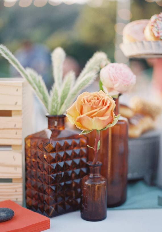 Love the small, vintage bottles. Cool centerpiece idea. Amber glassware   photo by Michael Radford   100 Layer Cake