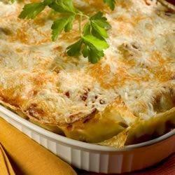 Fresh pasta sheets baked with ricotta, feta, eggplant, tomato, pesto, pumpkin, Parmesan and mozzarella.
