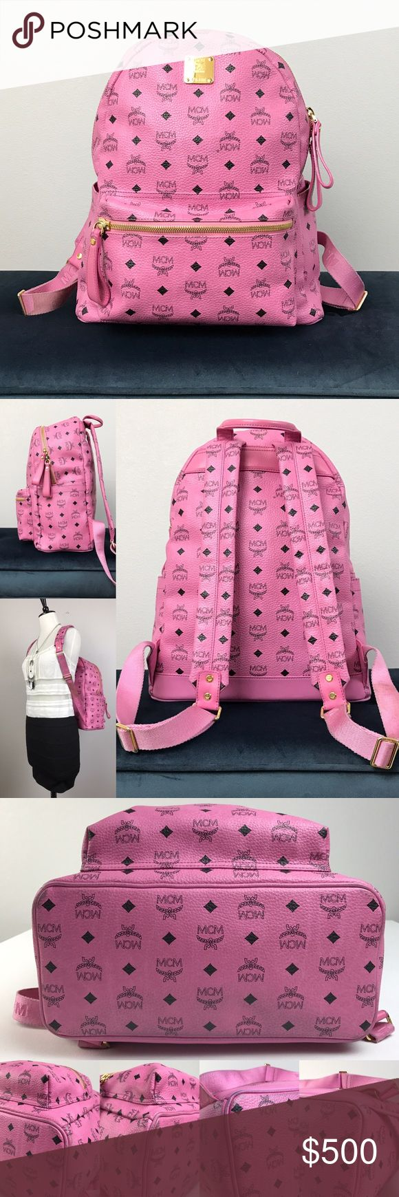 """MCM Visetos Medium Pink Backpack MCM Visetos Medium  Pink Backpack. MCM Monogram-stamped coated canvas, gold logo plaque, top handle, adjustable padded shoulder straps, two-way top zip closure & front zip pocket.  Interior features signature lining, padded laptop sleeve, zip pocket & slip pocket.     In great pre-owned condition.  Stains and slight wears at the bottom and corners.  Minor scuffs on the exterior, minor interior lining wear, stains on the straps.      Dimension:   13"""" L x 6"""" W…"""
