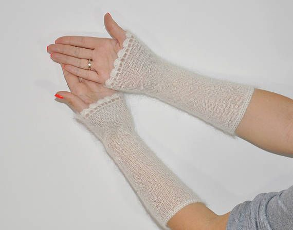 Blue long arm warmers mohair knitted hand warmers wedding mittens white bridal gloves long knit mittens mohair wrist warmers gift for her  >Dimensions: width top ~ 4.3 inches ( ~ 11 cm) length ~ 9.45 inches ( ~ 24 cm)  >Material: Kid Mohair / polyamide  >Color: blue or white with shine  >Care: gentle care, hand wash in warm water with mild soap, press into dry towel, lie flat to dry. Do not iron!  Custom orders welcome. Want a different color or a different size - I can knit ...