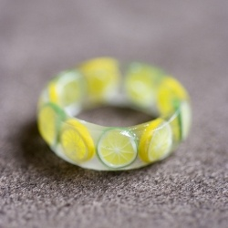 I love this version of miniature polymer clay foodstuffs- it's mini citrus in resin ring.