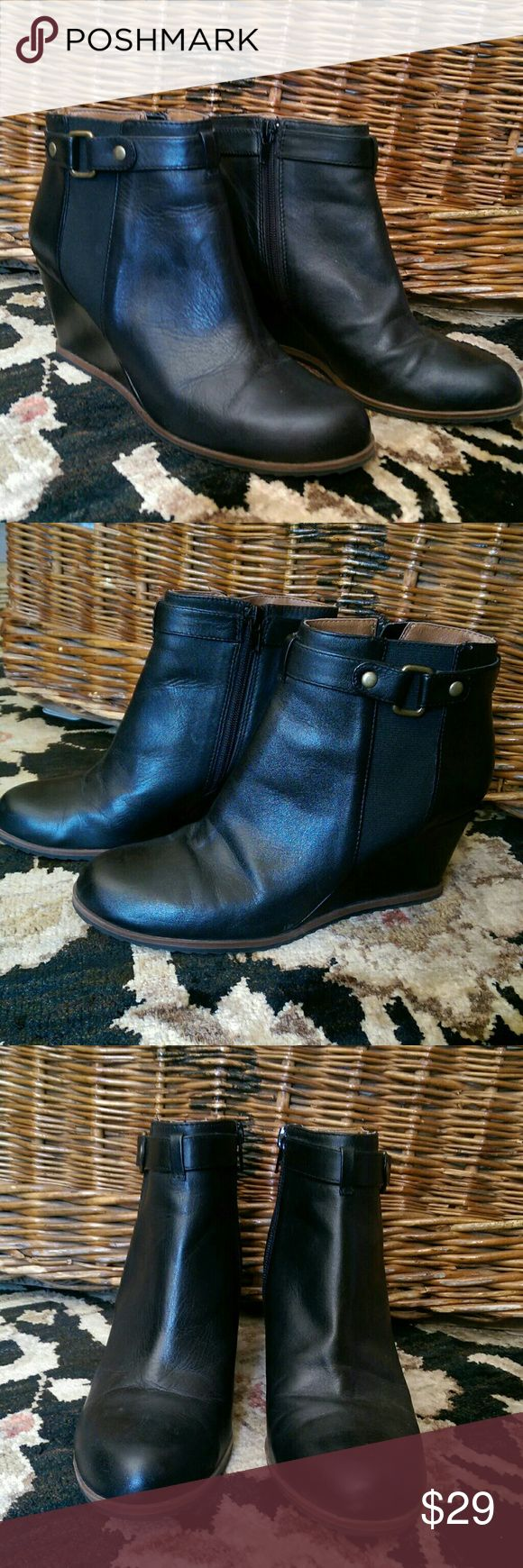 Black leather Susina wedge boots Sleek and stylish with minimal wear (only worn three times), these versatile Susina boots are great with jeans, Capri pants, or skirts! Cute wedge heel, buckle detail and comfy arch support too! Susina Shoes Heeled Boots