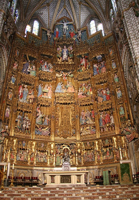 Toledo Cathedral, high altarpiece includes biblical vignettes of carved wood and poly chrome.