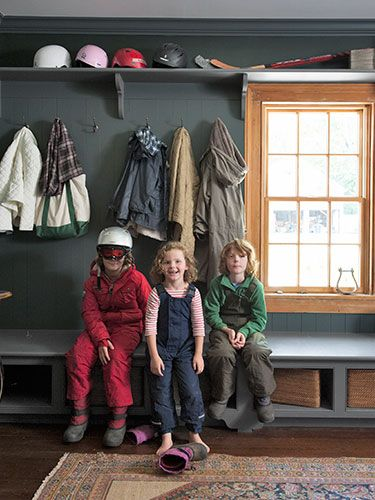 Mudroom - bench seat with open storage, hooks and shelf above window for helmets and sports equipment
