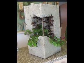 Pflanzsäule aus Beton Tücher und Plastikrohr ein…