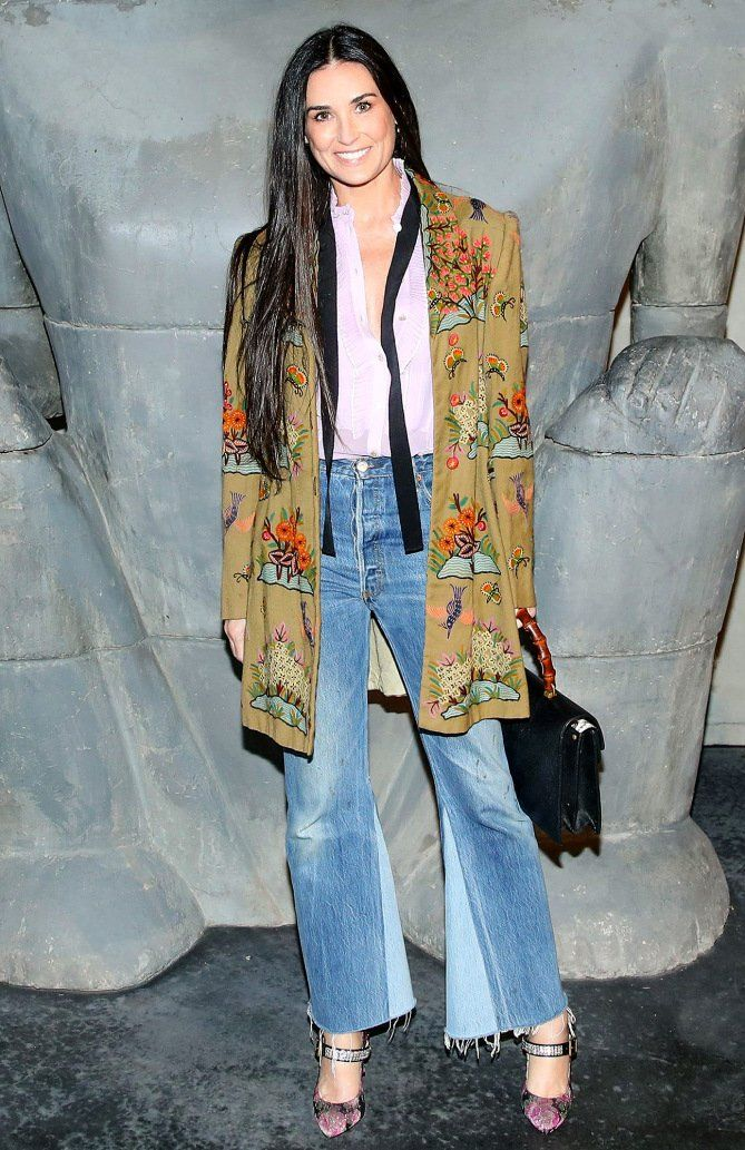Demi Moore in a printed Gucci jacket and flare jeans