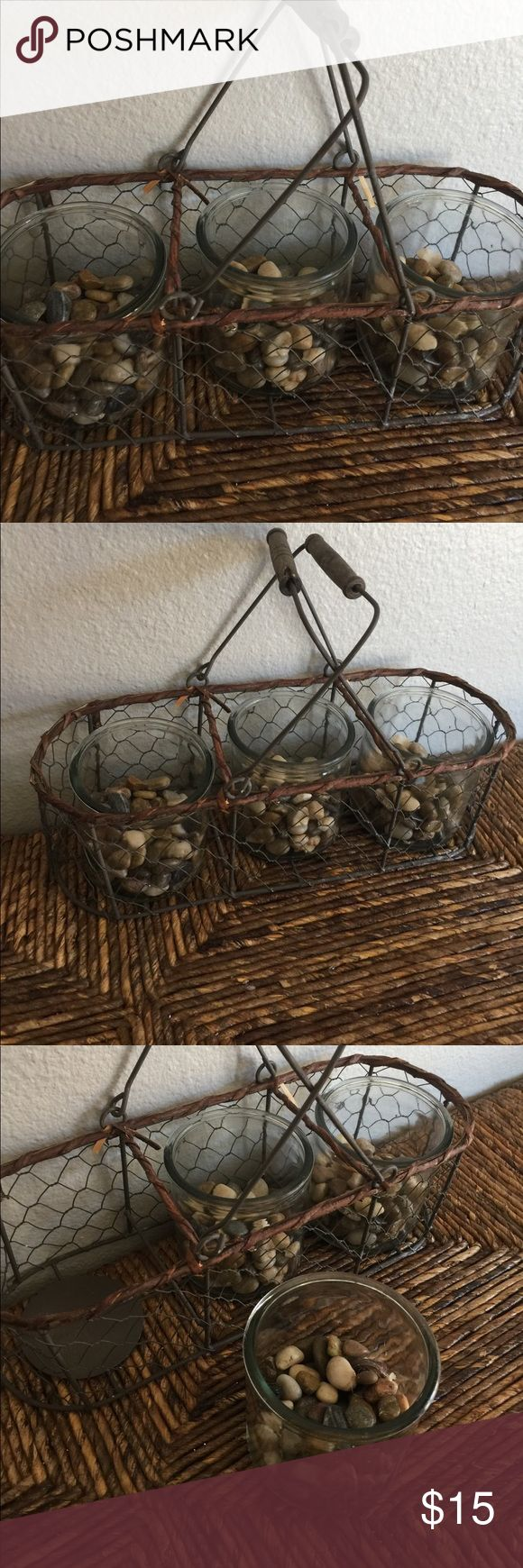 Home Decor wire basket Wired basket with glass jars & rocks in each glass jar. Used for whatever you can think of, I had my make up brushes stored in one and the rocks held them in place. home decor Other