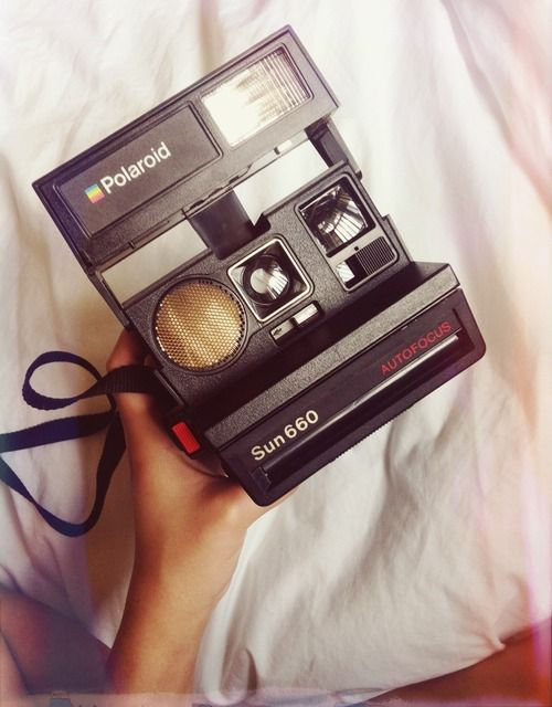 Own a Polaroid camera -- I have this one now :D