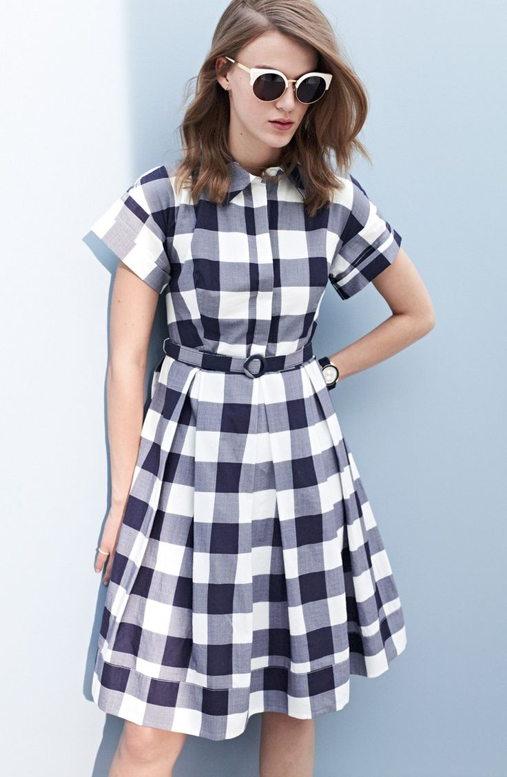 Channeling the '50s in this gingham check fit-and-flare dress, complete with a matching belt at the waist for an enhanced silhouette.