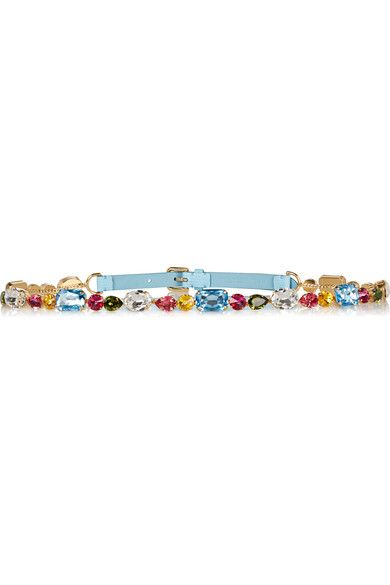 In rich jeweled shades, the faceted crystals that adorn Dolce & Gabbana's lizard-effect leather belt are inspired by the Italian destination, Portofino. Thread this azure style through the loops of your shorts or wear it to define loose silhouettes.