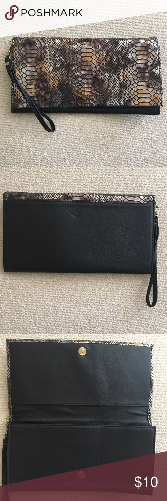 Deena & Ozzy Clutch (Urban Outfitters) Gently used black and snake skin pattern clutch with wrist strap. Deena & Ozzy Bags Clutches & Wristlets