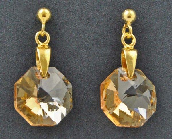 Kolczyki wykonane z kryształów Swarovskiego oraz srebra próby 925 pozłacanego. Sprawdź na www.bizuteriapiotrowski.pl!