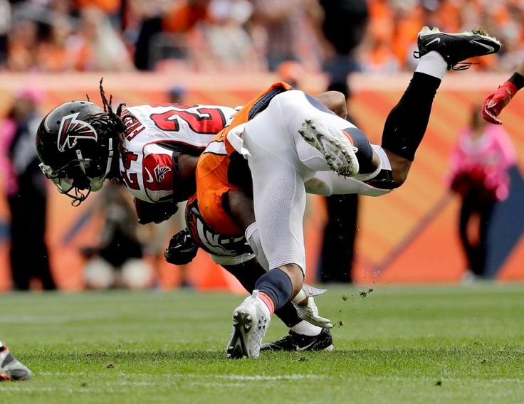 Falcons vs. Broncos:   October 9, 2016  -  23-16, Falcons.      Atlanta Falcons running back Devonta Freeman (24) is hit by Denver Broncos strong safety T.J. Ward during the first half of an NFL football game, Sunday, Oct. 9, 2016, in Denver.